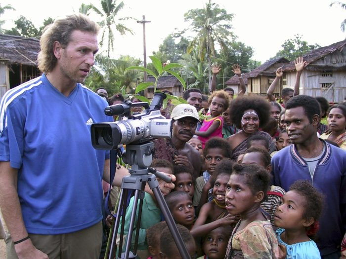 Julian Newman filming an event in Manggroholo village, West Papua, Indonesia.