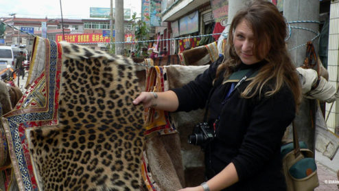 Debbie Banks with a leopard skin garment in Asia