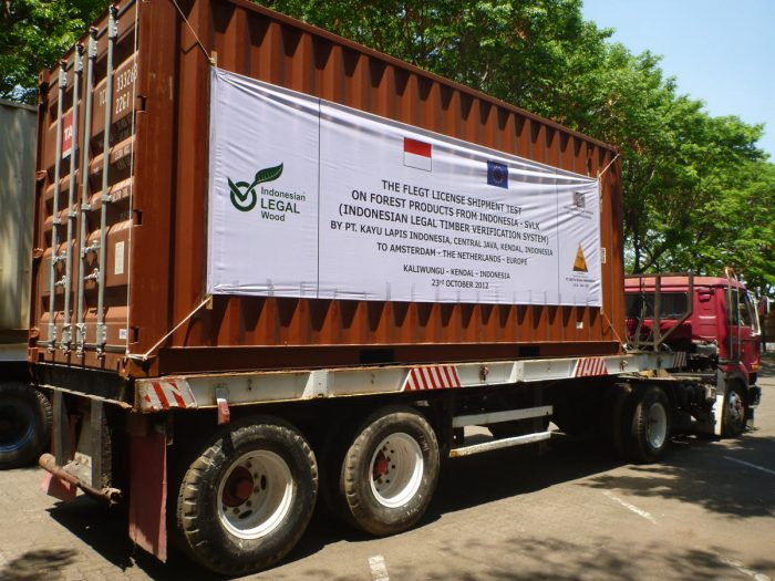 A truck loaded with a timber container covered with a banner - First Trial Shipment Timber Export to Anwerp - 2012-10-23