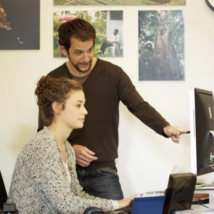 Janika consulting with EIA Visual Communications Co-ordinator Jamie Elkins (c) EIA