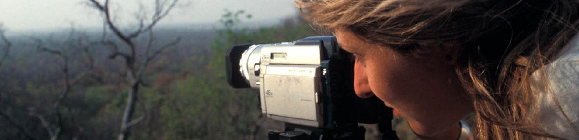 Debbie banks using a video camera, India