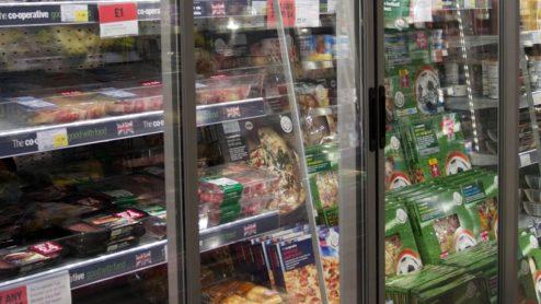 Supermarket aisle with refrigerators