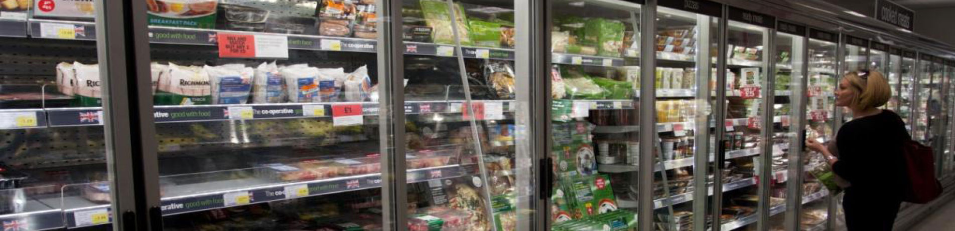 Supermarket aisle with refrigerators