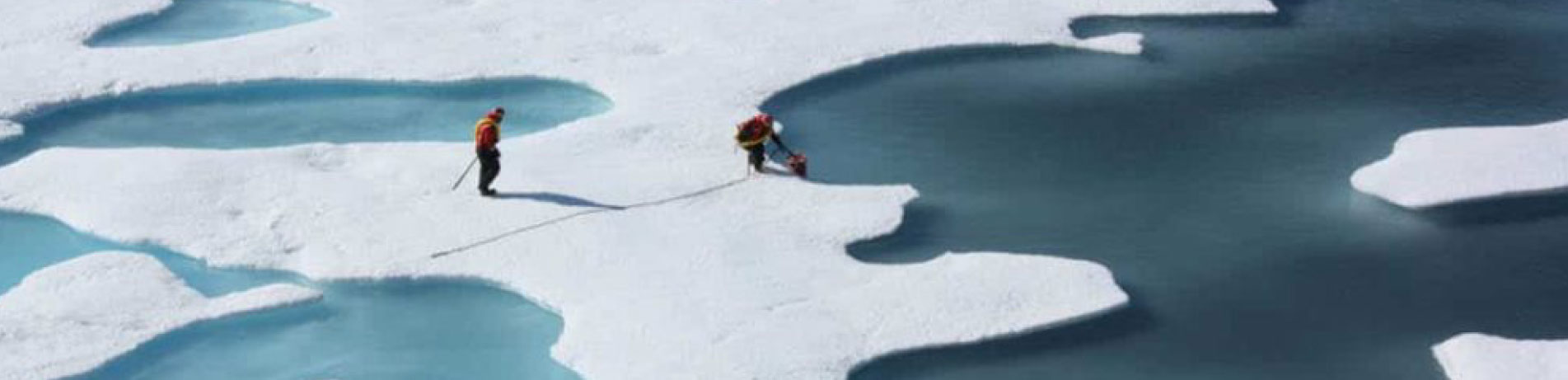 Scientists taking measurements on polar ice