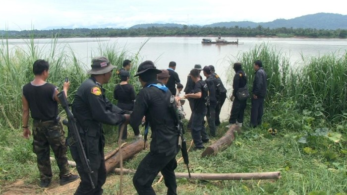 DNP Rangers and Thai Army recover rosewood from a smuggling point on the Mekong River bordering Laos.  The smugglers fled the scene but the wood was confiscated.  Along Thailand's Mekong River border with Laos, huge volumes of Thai rosewood are disappearing across the border (c) Roger Arnold