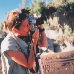 A picture of Mary Rice, CEO of the Environmental Investigation Agency, holding a camera